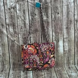 Vera Bradley handbag with chain handles.